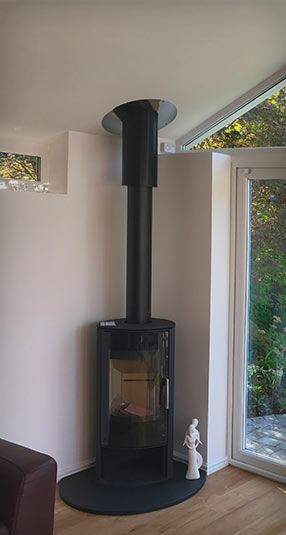 Modern log burner fireplace in the corner of a conservatory