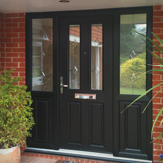 Black door with two glass panels and diamond motif