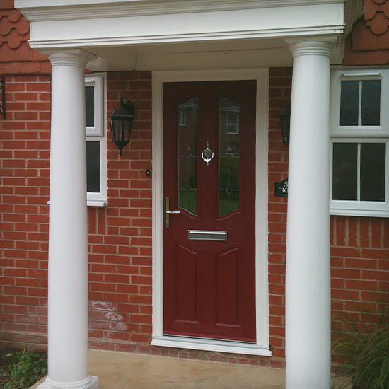 Poppy Red coloured door within rounded pillar porch