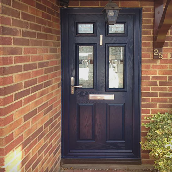 Deep blue door with four glass panels