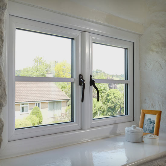 Casement window set in a thick stone walled period property wall