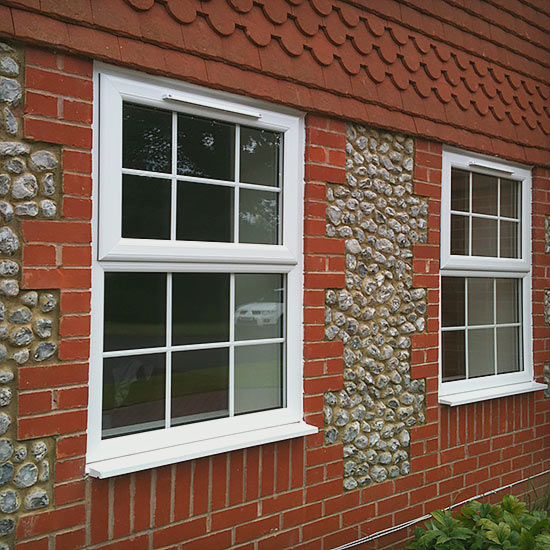 Casement upvc white frame wondows in a brick wall