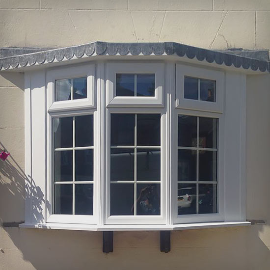 Bay window installation external view showing lead roof