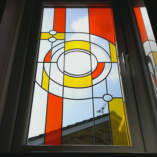 Red and yellow stained glass window internal view